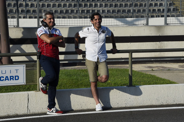 Xevi Pujolar, far left, stands next to Diego Mejia. Juan Manuel Correa (USA) Alfa Romeo Racing in his first Formula 1 test in a Sauber C32 fitted with Ferrari V8 atmospheric engine