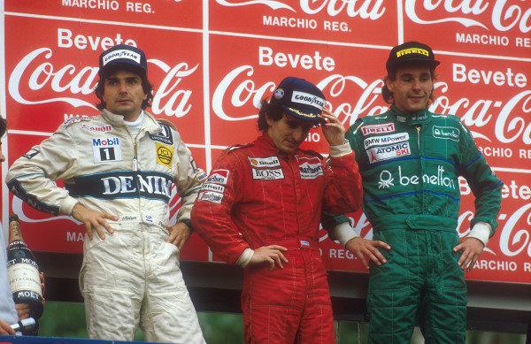 1986 San Marino Grand Prix.  Imola, Italy.25-27 April 1986.  Alain Prost (McLaren TAG Porsche) 1st position, Nelson Piquet (Williams Honda) 2nd position and Gerhard Berger (Benetton BMW) 3rd position on the podium.  Ref: 86SM15. World Copyright - LAT Photographic