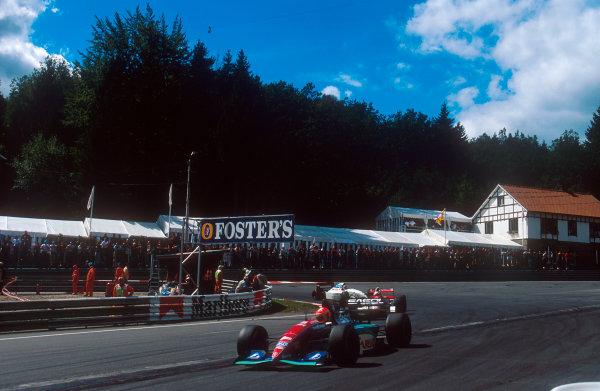 1994 Belgian Grand Prix.Spa-Francorchamps, Belgian.26-28 August 1994.Eddie Irvine (Jordan 194 Hart) followed by Martin Brundle (McLaren MP4/9 Peugeot) and Mark Blundell (Tyrrell 022 Yamaha) at La Source Hairin.Ref-94 BEL 18.World Copyright - LAT Photographic