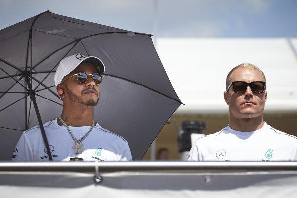 Lewis Hamilton, Mercedes AMG F1, with Valtteri Bottas, Mercedes AMG F1.