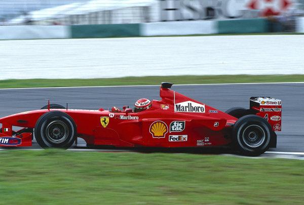 1999 Malaysian Grand Prix.Sepang, Kuala Lumpur, Malaysia. 15-17 October 1999.Eddie Irvine (Ferrari F399) 1st position.Ref-99 MAL 03.World Copyright - LAT Photographic
