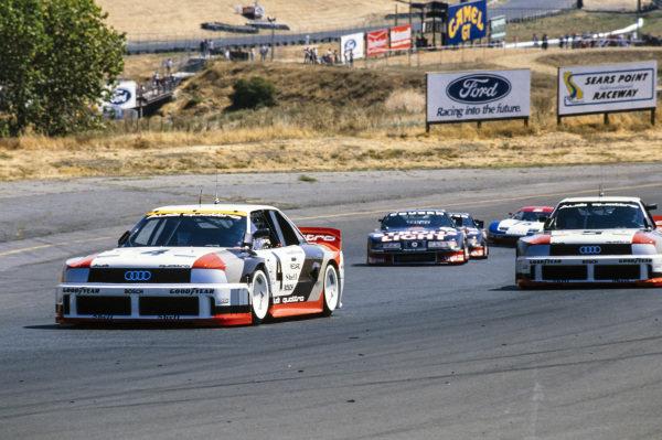 Hans-Joachim Stuck, Audi 90 quattro, leads Hurley Haywood, Audi 90 quattro.