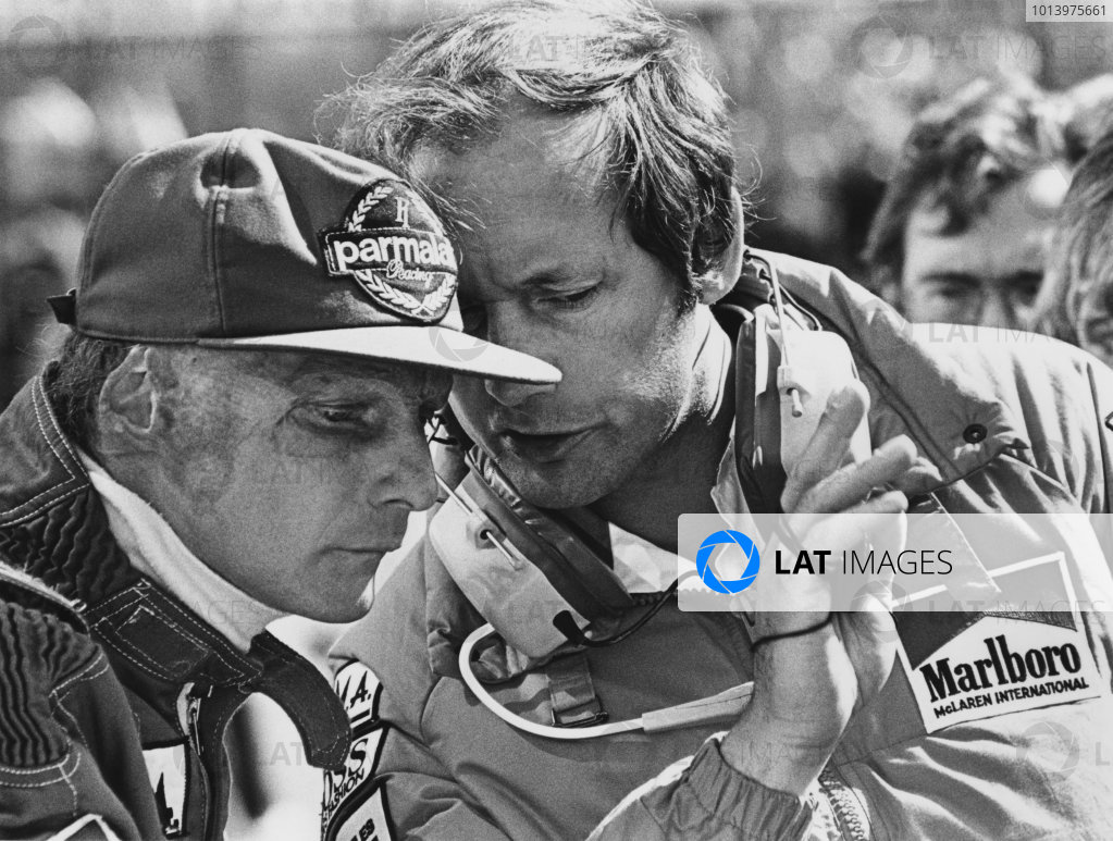 Zolder, Belgium. 27th - 29th April 1984. Niki Lauda (McLaren MP4/2 TAG Porsche), retired, with team boss, Ron Dennis, portrait. World Copyright: LAT Photographic. Ref: B/W Print.
