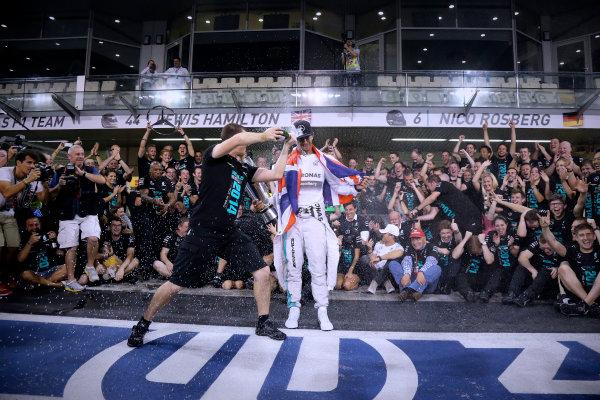 Yas Marina Circuit, Abu Dhabi, United Arab Emirates. Sunday 23 November 2014.  Lewis Hamilton and the Mercedes team celebrate championship victory.  World Copyright: Steve Etherington/LAT Photographic. ref: Digital Image SNE22533