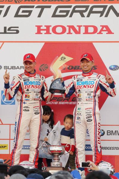 2016 Japanese Super GT Series. Motegi, Japan. 11th - 13th November 2016. Rd 8. GT500 Winner Heikki Kovalainen & Kohei Hirate ( #39 DENSO KOBELCO SARD RC F ) podium portrait World Copyright: Yasushi Ishihara/LAT Photographic Ref: 2016SGT_Rd8_MOTEGI005