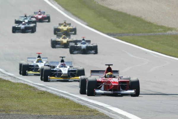 2004 Formula 3000 Championship (F3000) Nurburgring, Germany.29th May 2004. Esteban Guerrieri (BCN F3000) leads Tony Schmidt (Ma-Con) and Tomas Enge (Ma-Con Engineering). Action.World Copyright: LAT Photographic ref: Digital Image Only