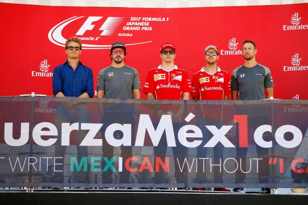 Suzuka Circuit, Japan. Sunday 08 October 2017. Nico Rosberg, Fernando Alonso, McLaren, Kimi Raikkonen, Ferrari, Sebastian Vettel, Ferrari, and Jenson Button take part in an event in support of Mexico on the podium. World Copyright: Andy Hone/LAT Images  ref: Digital Image _ONY8412