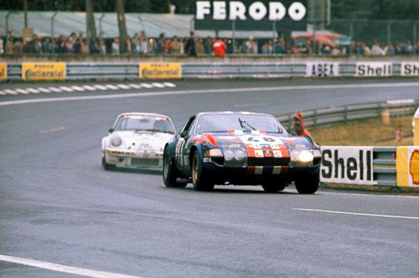 Le Mans, France. 14-15 June 1975 Marcel Mignot/Harry Jones/Philippe Gurdjian (Ferrari 365 GTB/4), 13th position, leads a Porsche Carrera RS, action. World Copyright: LAT PhotographicRef: 75LM12.