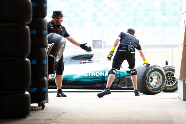 Bahrain International Circuit, Sakhir, Bahrain.  Thursday 13 April 2017. Mercedes team members in the pits. World Copyright: Sam Bloxham/LAT Images ref: Digital Image _J6I8512