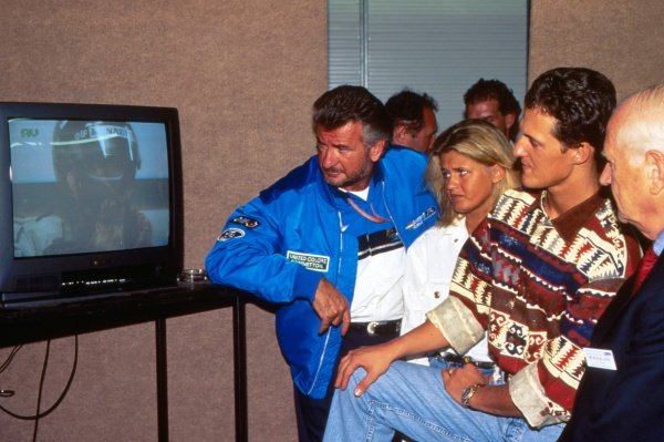 (L-R) Willi Weber (GER) Driver manager, Corinna Schumacher (GER) and Michael Schumacher (GER) Benetton, watch 1994 championship rival Damon Hill (GBR), Williams, on television.