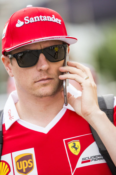 Kimi Raikkonen (FIN) Ferrari on the phone at Formula One World Championship, Rd18, United States Grand Prix, Preparations, Circuit of the Americas, Austin, Texas, USA, Thursday 20 October 2016.