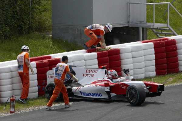 Jarno Trulli gets out of his damaged Toyota TF109 after a first lap accident.