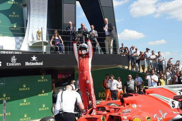Race winner Sebastian Vettel (GER) Ferrari SF-71H celebrates in parc ferme
