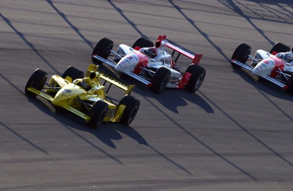 IRL Delphi Indy 300, Chicagoland Speedway, Joliet ,Illinois, USA 8 September, 2002 The Team Penske drivers (Helio Castroneves,#3 and Gil deFerran #6) harass championship rival Sam Hornish,Jr. (#4) during final practice.