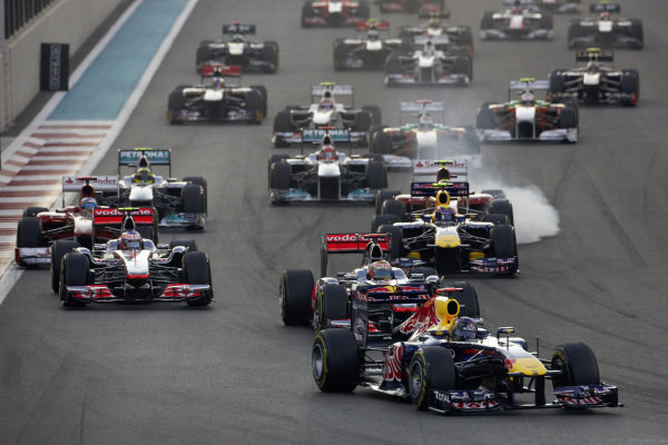Sebastian Vettel, Red Bull RB7 Renault, leads Lewis Hamilton, McLaren MP4-26 Mercedes, Jenson Button, McLaren MP4-26 Mercedes, Mark Webber, Red Bull RB7 Renault, Fernando Alonso, Ferrari 150° Italia, and Felipe Massa, Ferrari 150° Italia, who locks up.