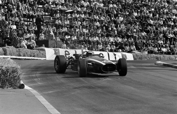 Jochen Rindt, Cooper T81B Maserati, gets sideways on the exit of the Station Hairpin.