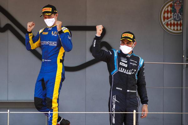 Roy Nissany (ISR, DAMS) and Felipe Drugovich (BRA, Uni-Virtuosi) celebrate on the podium