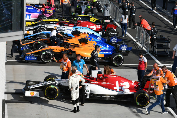 Cars, mechanics and scrutineers in Parc Ferme after the race