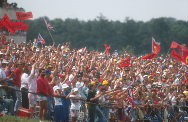 1990 British Grand Prix.Silverstone, England.13-15 July 1990.There was a big crowd at Silverstone. Many fans supporting Ferrari in the hope that home hero Nigel Mansell would win. Ref-90 GB 31.World Copyright - LAT Photographic