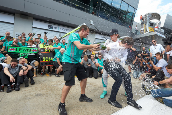 Red Bull Ring, Spielberg, Austria. Sunday 22 June 2014. Nico Rosberg, Mercedes AMG, 1st Position, and the Mercedes AMG team celebrate victory after the race. World Copyright: Steve Etherington/LAT Photographic. ref: Digital Image SNE26779copy