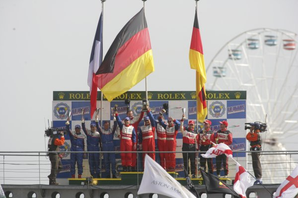 2006 Le Mans 24 Hours, Le Mans, France.14th - 18th June. LMP2 Podium.Th Erdos (GBR)/ M Newton (GBR)/ A Wallace (GBR), RML, Lola AER. and B Binnie (USA)/ A Timpany (GBR)/ Y Terada (JPN), Binnie Motorsports, Lola Zytek. and J Macaluso (USA)/ A Lally (USA)/ I James (GBR), Miracle Motorsports, Courage AER. Celebrate on the podium.World Copyright: Andrew Ferraro/LAT PhotographicRef: Digital Image Only ZP9O1554