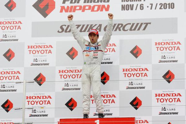 Rd 7 Suzuka, Japan. 6th - 7th November 2010.Race2, Winner Joao Paulo de Oliveira ( #19 Mobil1 TEAM IMPUL ) podium.World Copyright: Yasushi Ishihara/LAT Photographic.Ref: 2010FN_R7_017.