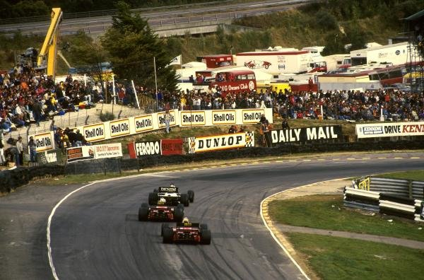 The cars go into Paddock Hill Bend.