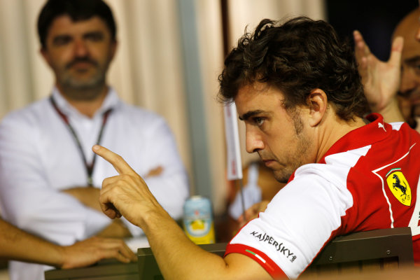 Marina Bay Circuit, Singapore. Friday 20th September 2013. Fernando Alonso, Ferrari in the paddock with his manager Luis Garcia Abad. World Copyright: Charles Coates/LAT Photographic. ref: Digital Image _N7T3248