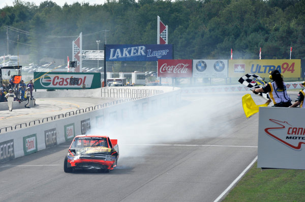 30 August - 1 September 2013, Bowmanville, Ontario Canada Ty Dillon damaged from a last turn crash crosses the finish line under the checkered flag ©2013, Scott R LePage LAT Photo USA