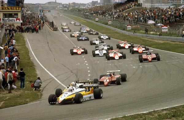 Zandvoort, Holland.1-3 July 1982.Alain Prost and Rene Arnoux (both Renault RE30B's),lead Didier Pironi and Patrick Tambay (both Ferrari 126C2's) into Tarzan at the start.Ref-82 HOL 29.World Copyright - LAT Photographic