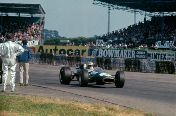 Silverstone, England. 13th - 15th July 1967. Denny Hulme (Brabham BT24-Repco), 2nd position, action.Ref: 67 GB 18 World Copyright: LAT Photographic
