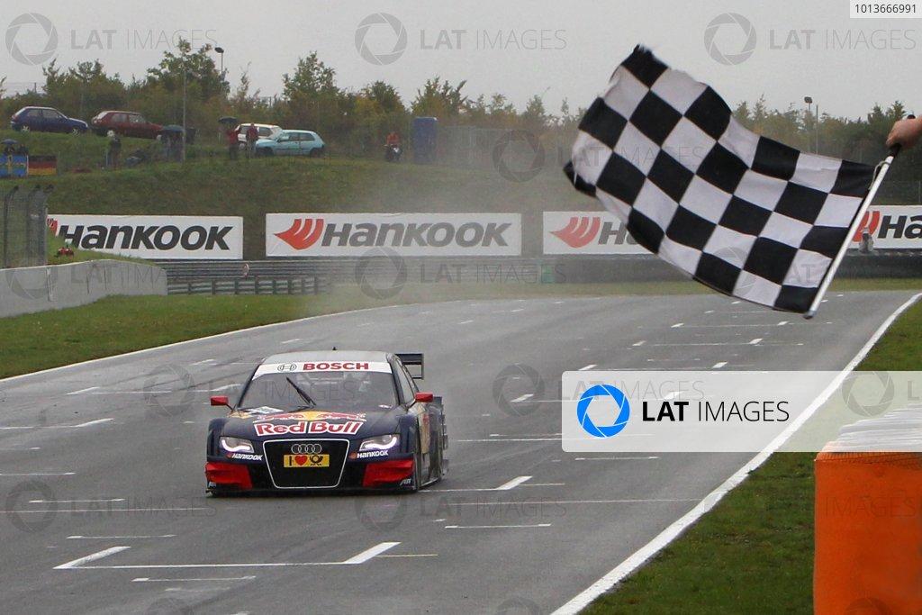 Race winner Mattias Ekstrom (SWE), Audi Sport Team Abt Sportsline, Red Bull Audi A4 DTM (2009), crosses the line to take victory.DTM, Rd8, Oschersleben, Germany, 16-18 September 2011 Ref: Digital Image dne1118se544