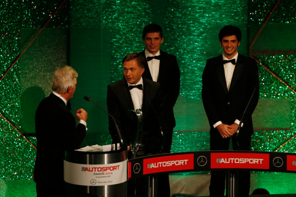 2014 Autosport Awards. Grosvenor House Hotel, Park Lane, London. Sunday 7 December 2014. Max Verstappen and Carlos Sainz Jr present the Rally Car of the Year award to Jost Capito for the Volkswagen Polo R WRC. World Copyright: Sam Bloxham/LAT Photographic. ref: Digital Image _14P3853