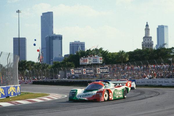 Miami 3 hours, Florida, USA. 28th February 1988. Rd 2. Oscar Larrauri/Massimo Sigala (Porsche 962), 3rd position, action. World Copyright: LAT Photographic. Ref: 88IMSA MIA01.