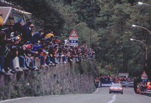 2003 World Rally ChampionshipRally of San Remo, Italy. 2nd - 5th October 2003.Sebastien Loeb / Daniel Elena, Citroen Xsara. Approaching, uphill. Spectators on wall. Action.World Copyright: McKLEIN/LATref: 35mm Image WRCSANREMO02 jpg