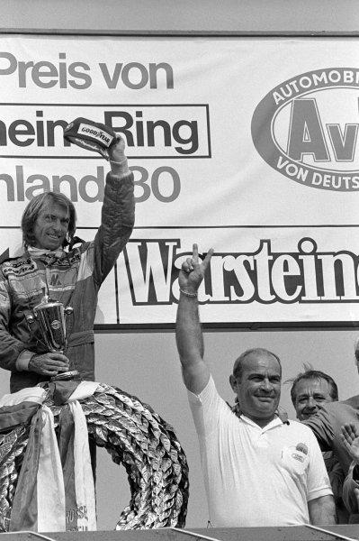 The podium (L to R): Race winner Jacques Laffite (FRA) Ligier, celebrates with Guy Ligier (FRA) Ligier Team Owner.Formula One World Championship, German Grand Prix, Rd9, Hockenheim, 10 August 1980.