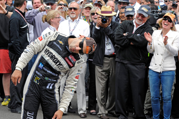 """26 May, 2013, Indianapolis, Indiana, USA Winner Tony Kanaan (#11) mugs for the cameras about kissing the """"Yard of Bricks"""" without getting his famously large nose in the way. ©2013, F. Peirce Williams LAT Photo USA"""