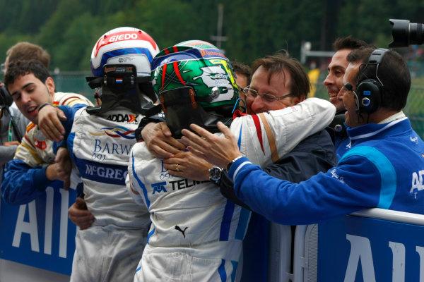 Spa - Francorchamps, Spa, Belgium. 29th August.Sunday Race.Sergio Perez (MEX, Barwa Addax Team) celebratrates his victory with team mate Giedo Van der Garde (NED, Barwa Addax Team) and the rest of the team. Photo: Charles Coates/GP2 Media Service.Ref: __26Y5731 jpg