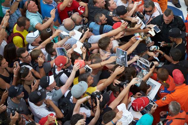 Autodromo Nazionale di Monza, Monza, Italy. Thursday 3 September 2015. Lewis Hamilton, Mercedes AMG, signs autographs for fans. World Copyright: Steve Etherington/LAT Photographic ref: Digital Image SNE23386
