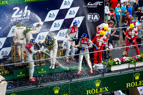 2016 Le Mans 24 Hours. Circuit de la Sarthe, Le Mans, France. Sunday 19 June 2016. Porsche Team / Porsche 919 Hybrid - Romain Dumas (FRA), Neel Jani (CHE), Marc Lieb (DEU), Toyota Gazoo Racing / Toyota TS050 - Hybrid - Stephane Sarrazin (FRA), Michael Conway (GBR), Kamui Kobayashi (JPN), Audi Sport Team Joest / Audi R18 - Lucas Di Grassi (BRA), Loic Duval (FRA), Oliver Jarvis (GBR), Rebellion Racing / Rebellion R-One-AER - Nicolas Prost (FRA), Nick Heidfeld (DEU), Nelson Piquet (NLD).  World Copyright: Zak Mauger/LAT Photographic ref: Digital Image _79P9259
