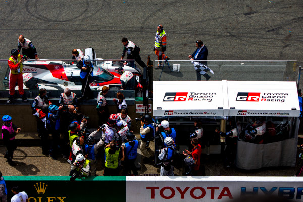 2016 Le Mans 24 Hours. Circuit de la Sarthe, Le Mans, France. Sunday 19 June 2016. Toyota Gazoo Racing / Toyota TS050 - Hybrid - Anthony Davidson (GBR), Sebastien Buemi (CHE), Kazuki Nakajima (JPN), stops on track outside the Toyota pit wall. World Copyright: Zak Mauger/LAT Photographic ref: Digital Image _79P8927