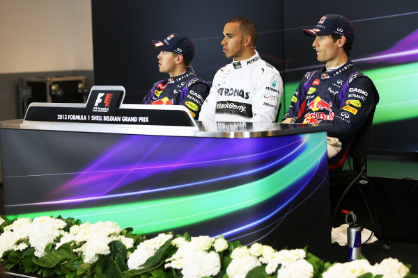 Spa-Francorchamps, Spa, Belgium. 24th August 2013. Lewis Hamilton, Mercedes AMG, Sebastian Vettel, Red Bull Racing, and Mark Webber, Red Bull Racing, in the post qualifying Press Conference. World Copyright: Sam Bloxham/LAT Photographic. ref: Digital Image BH2I0345.
