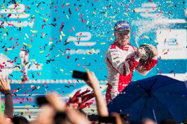 2016/2017 FIA Formula E Championship. Round 7 - Berlin ePrix, Tempelhof Airport, Berlin, Germany. Saturday 10 June 2017. Felix Rosenqvist (SWE), Mahindra Racing, Spark-Mahindra, Mahindra M3ELECTRO, sprays the champagne on the podium. Photo: Zak Mauger/LAT/Formula E ref: Digital Image _54I7712