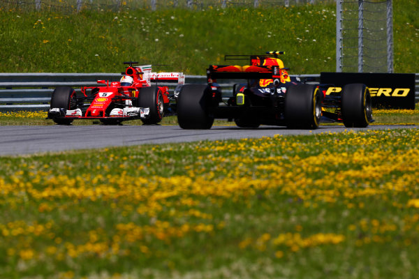 Red Bull Ring, Spielberg, Austria. Friday 07 July 2017. Sebastian Vettel, Ferrari SF70H, spins in FP1 a Max Verstappen, Red Bull Racing RB13 TAG Heuer, passes by. World Copyright: Andy Hone/LAT Images ref: Digital Image _ONZ9214