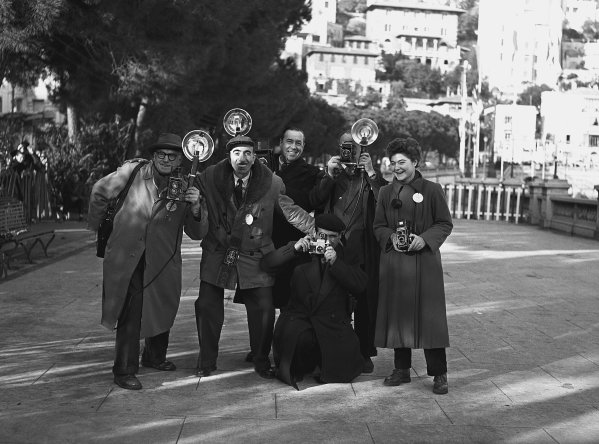 1953 Monte Carlo Rally. Monte Carlo, Monaco. 20th January - 27th January 1953. A group of photographers pose foe a camera. World Copyright: LAT Photographic. Ref:  Autocar Glass Plate C31088.