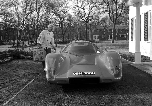 Pat Mclaren with the Mclaren M6GT road car outside their house in Surrey, England early in 1970