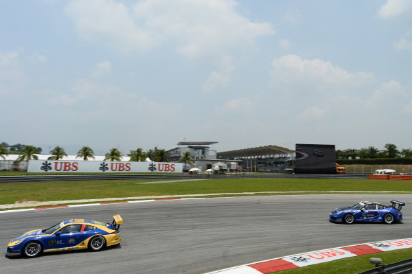 Zhan Zhen Dong (CHN) Team Basetex and Alif Hamdan (MAS) Nexus Racing. Porsche Carrera Cup Asia, Sepang, Malaysia, 28-30 March 2014.