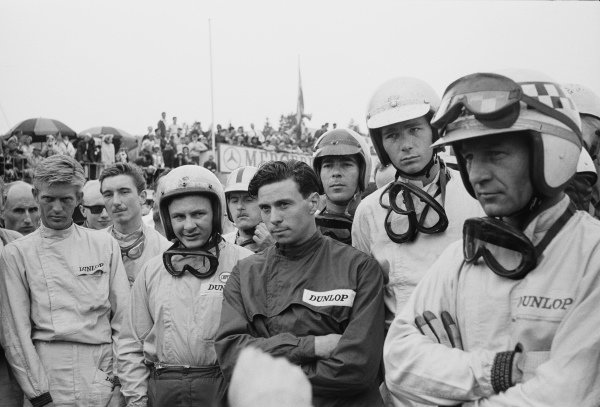 (Left to right) Tony Maggs, Jo Siffert, Bruce McLaren, Lucien Bianchi, Jim Clark, Tony Settember, Jim Hall and Innes Ireland attend the drivers' briefing before the start.