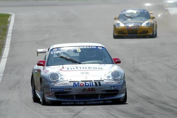 Frank Stippler (GER) Infineon - Team Farnbacher leads Patrick Huisman (NED) DeWalt Racing.Porsche Supercup, Rd8, Hockenheim, Germany,3 August 2003.DIGITAL IMAGE