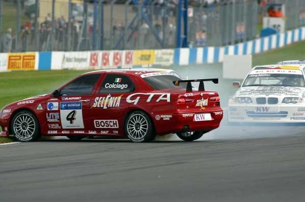 Roberto Colciago (ITA) Alfa Romeo spins while challenging Dirk Muller (GER) BMW Team Deutschland for the lead into the first corner in race 1.European Touring Car Championship, Round 9, Donnington Park, England. 4-6 October 2002.DIGITAL IMAGE